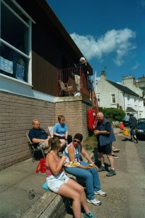 Members enjoying some summer sunshine outside the clubhouse in between training sessions